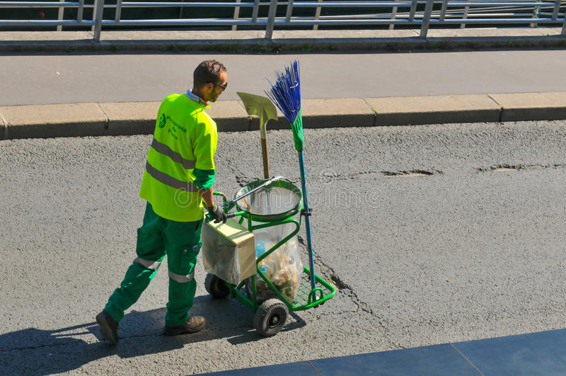 Street cleaner in Paris royalty free stock photography