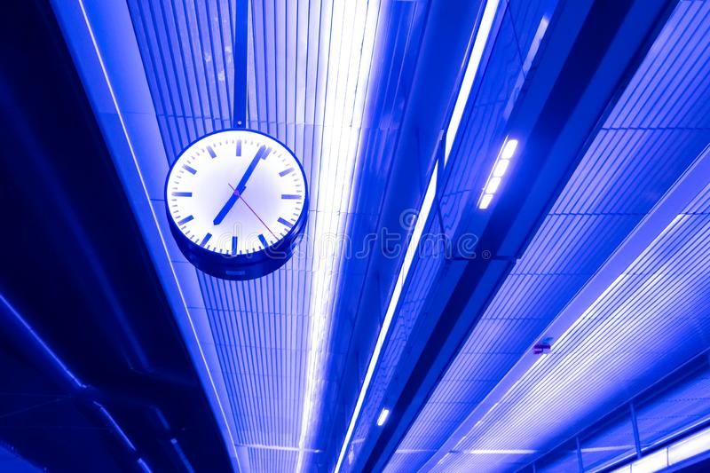 Street clock. On the ceiling with neon lights. Details. Architecture stock image
