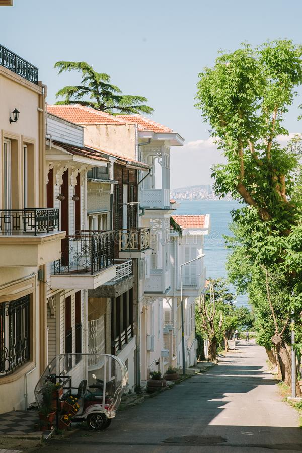 Street with colonial style buildings on the Princes` Islands, Istanbul, Turkey. Narrow street in the summer afternoon with colonial style buildings on the stock photos