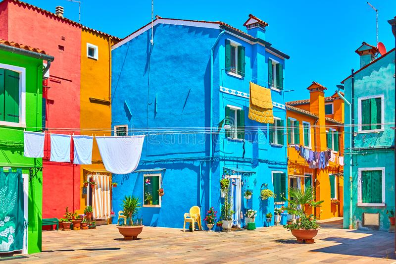 Street with colorful houses in Burano stock photos