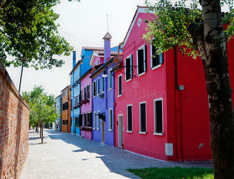 Street with colorful houses in Burano, Italy royalty free stock images