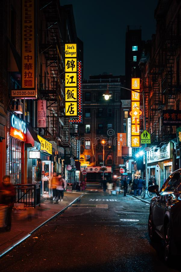 A street with colorful signs at night in Chinatown, Manhattan, New York City.  stock image