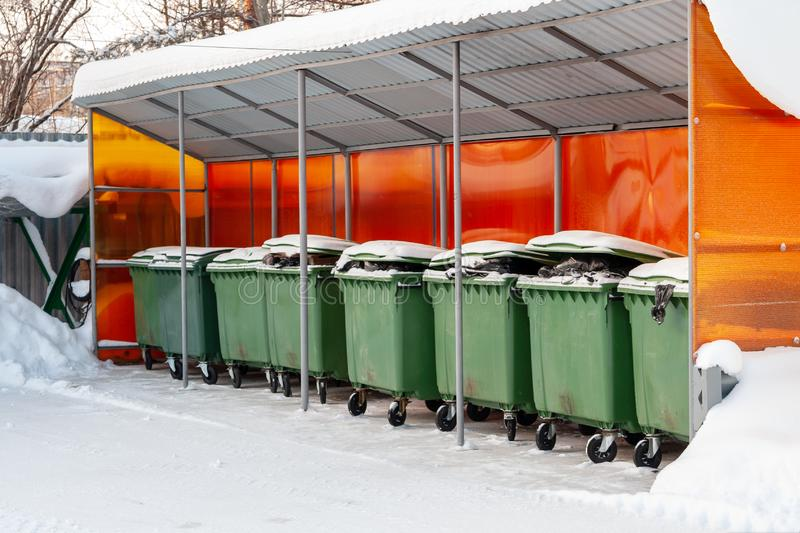 Street containers for the collection of household waste, under a canopy royalty free stock images