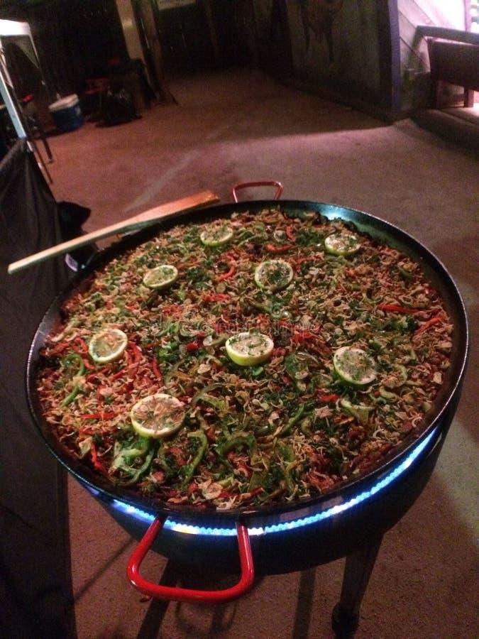 Huge pan of paella stock image