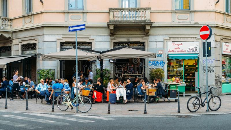 Street corner cafe terrace in the Porta Venezia district of Milan, Lombardy, Italy stock photography