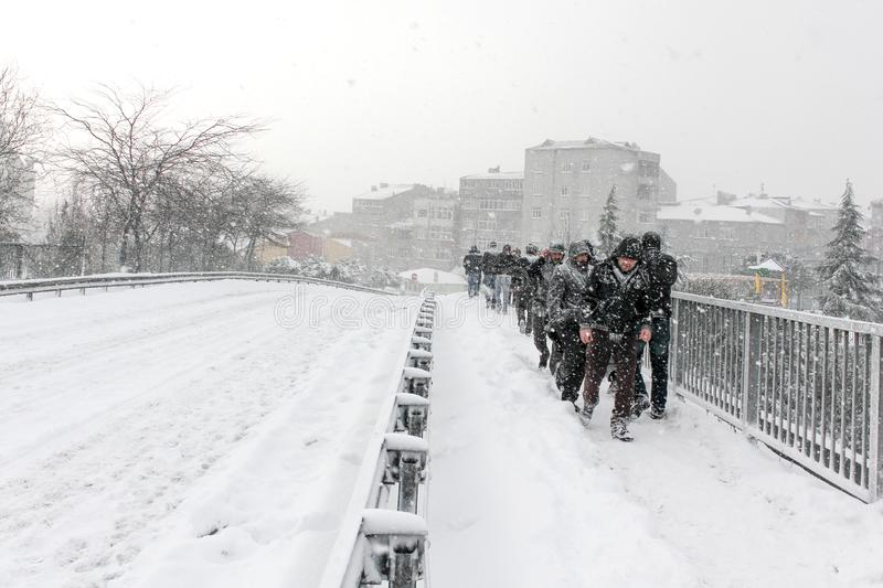 Street covered with snow and People walking heavy snowfall. stock photo