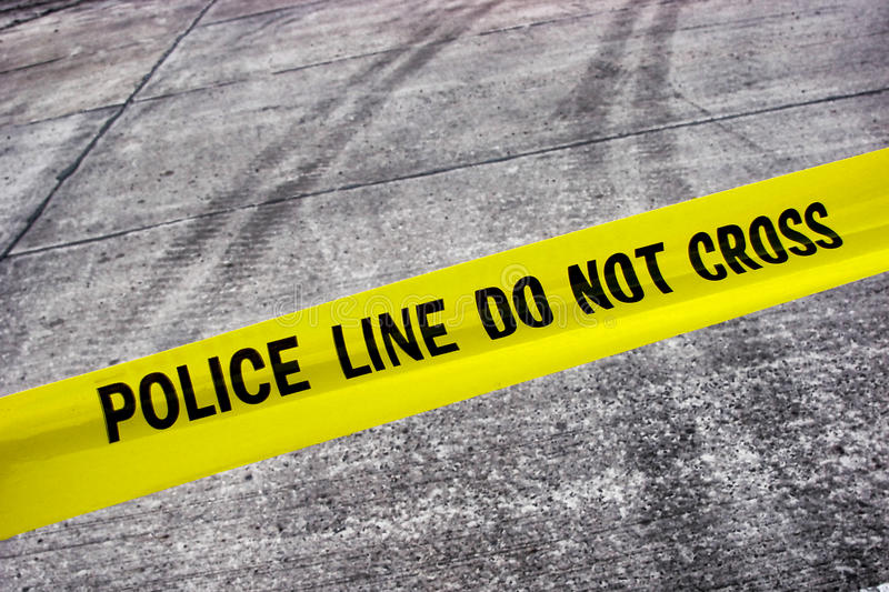 Street Crime Scene with Police Line Tape royalty free stock photos