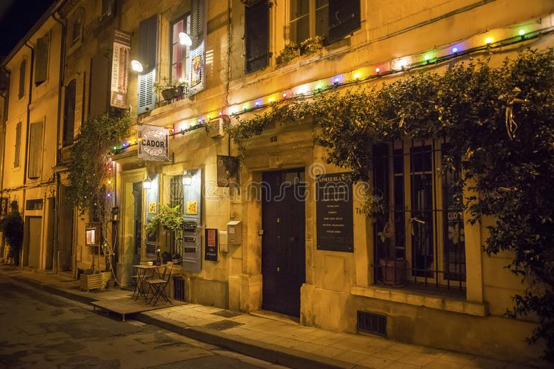 Street and restaurant at night, Arles, Bouches-du-Rhone, France stock photography