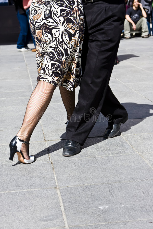 Street dancers playing tango stock image