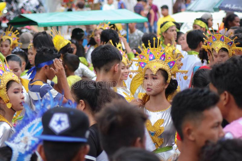 Street dancing participants wearing colorful costumes in the Philippines. NAGA CITY, CAMARINES SUR / PHILIPPINES - SEPTEMBER 13, 2018: Street dancing royalty free stock images