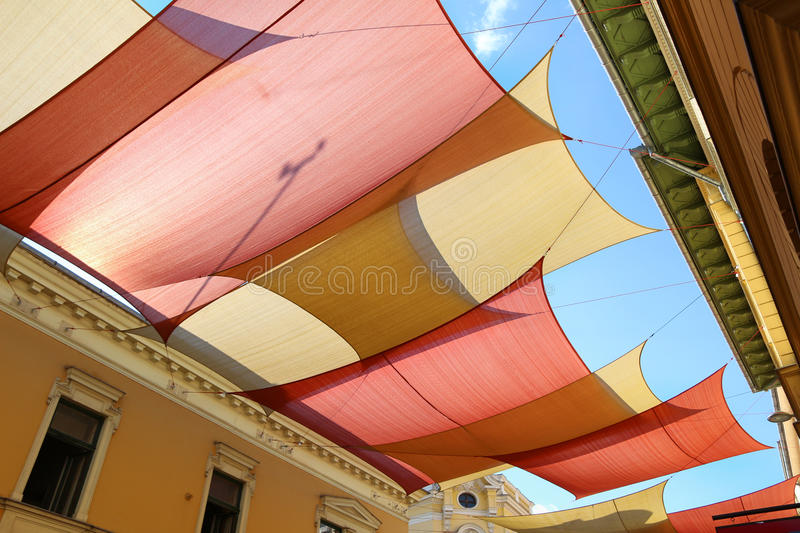 Street decorated with colored canvas awnings stock images