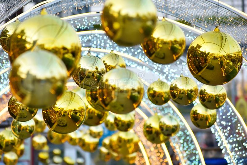 Street decoration for the new year. Christmas golden big balls. Christmas decorations outdoor royalty free stock image