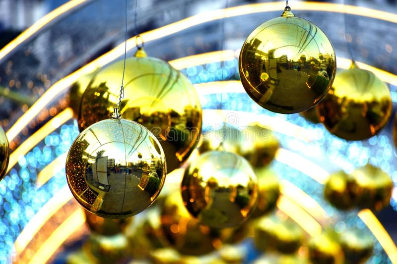 Street decoration for the new year. Christmas golden big balls. Christmas decorations outdoor stock image