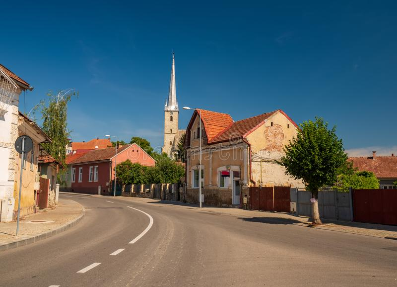 Street of Dej city, Cluj County, Transylvania, Romania. Gothic Reformed-Calvin Church on background stock image