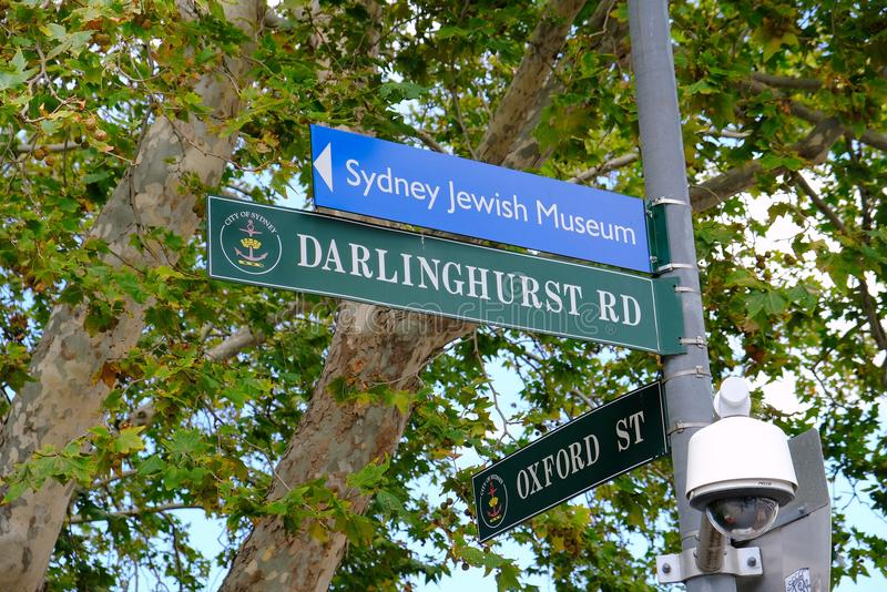 Sydney Street Sign; Darlinhurst Road and Oxford Street, Australia. Street and direction signs attached to a power pole; Darlinghurst Road, Oxford Street and royalty free stock image