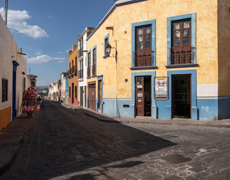 Street in downtown Queretaro Mexico. Colorful buildings and balloons on a downtown backstreet in Queretaro Mexico on a beautiful March morning stock photo