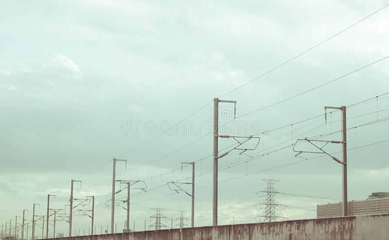Street electricity poles  aligned  on the road with beautiful blue sky in background.  stock photography