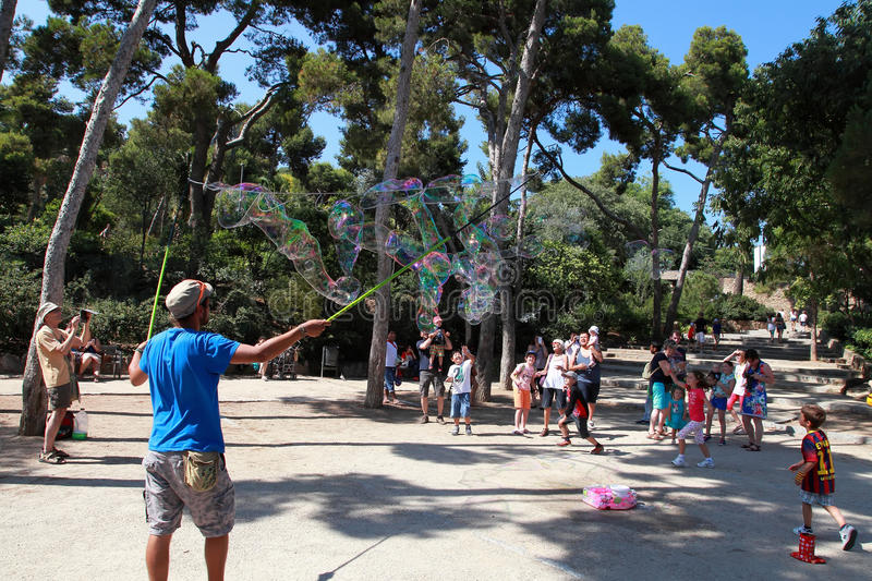 A street entertainer performs his bubble show for a group of tourists stock photography