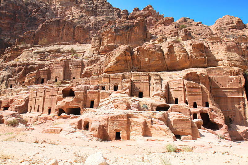 Street of Facades in Petra in Jordan. It was carve. Street of Facades, riddling the walls of the Outer Siq are over 40 tombs and houses built by the Nabataeans royalty free stock images