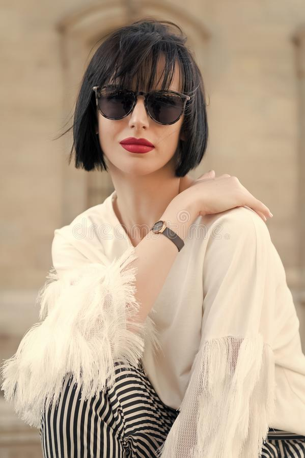 Street fashion concept. Portrait of elegant young beautiful woman. Paris buildings as background, France stock photography