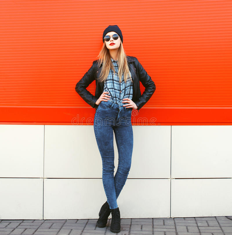Street fashion concept - stylish hipster woman in rock royalty free stock images