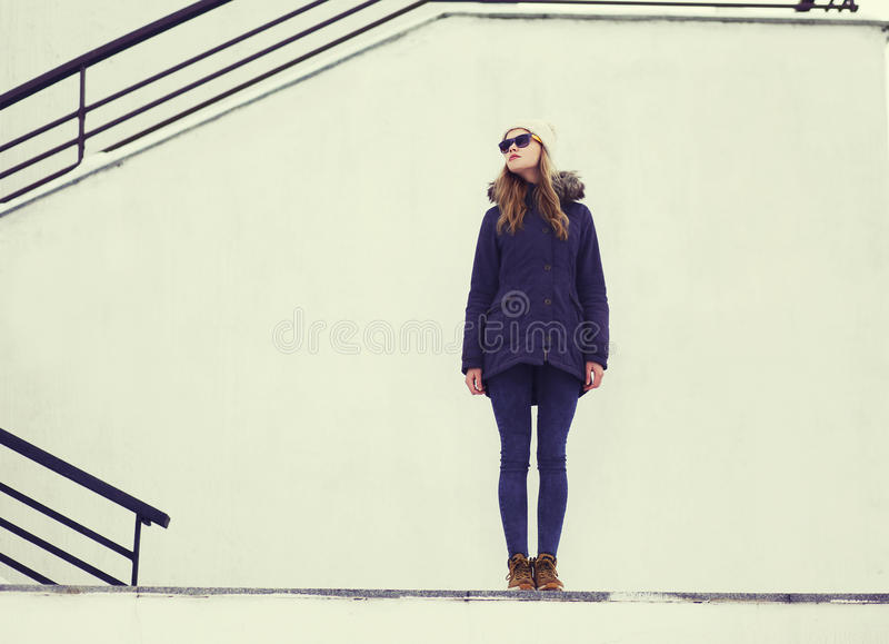 Street fashion concept - stylish pretty hipster girl royalty free stock photo