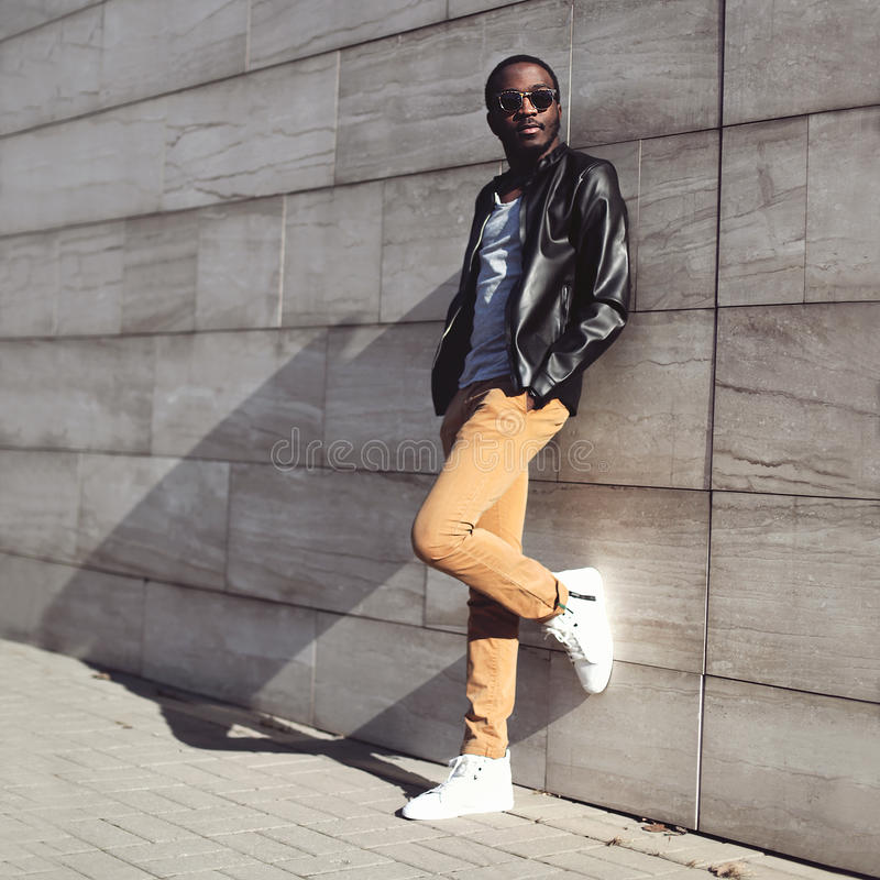 Street fashion, stylish young african man wearing a sunglasses stock photo