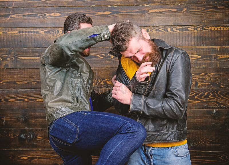 Street fight concept. Men brutal hooligans wear leather jackets fighting. Physical attack. Men bearded hipster fighting stock photos