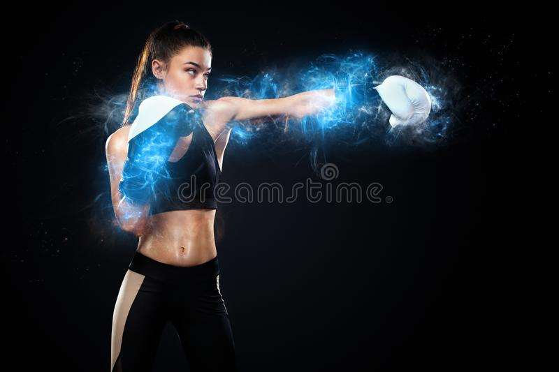 Sportsman, woman boxer fighting in gloves on black background. Boxing and fitness concept. Energy and motivation. Street fighter fighting in boxing gloves royalty free stock images