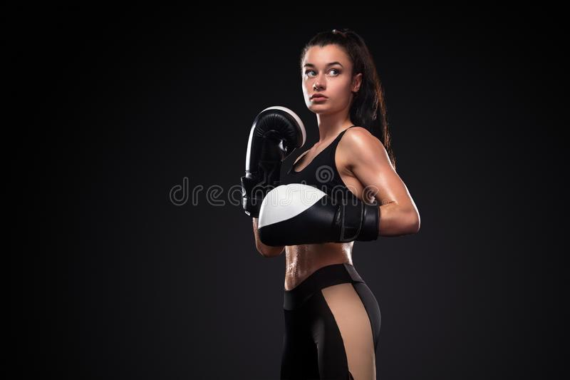 Woman boxer in boxing gloves on black background. Boxing and fitness concept. Street fighter fighting in boxing gloves. Isolated on black background with copy royalty free stock images