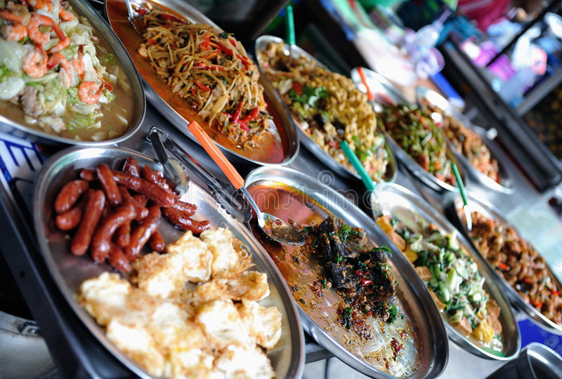Street food. Exposed food selling by the side of the street royalty free stock images