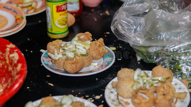 Street food in asia. panipuri, golgappa fried food. In a plate royalty free stock photo