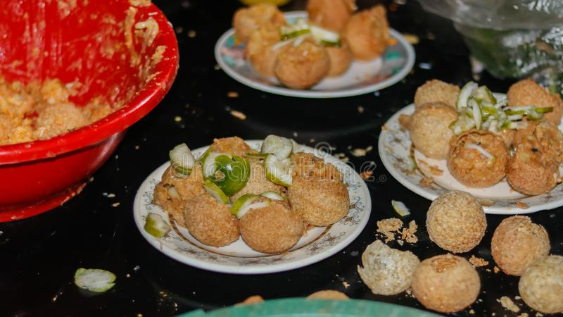 Street food in asia. panipuri, golgappa fried food. In a plate royalty free stock photos