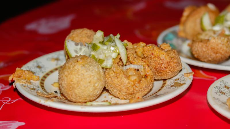 Street food in asia. panipuri, golgappa fried food. In a plate stock images