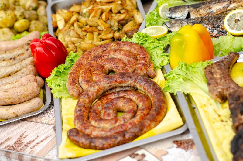 Street food, different fried sausages. Street food, different fried sausages royalty free stock images