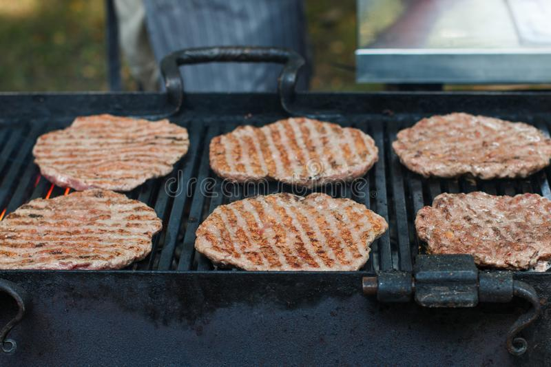 Street food. Fry meat patties burgers fresh beef. On the grill stock images