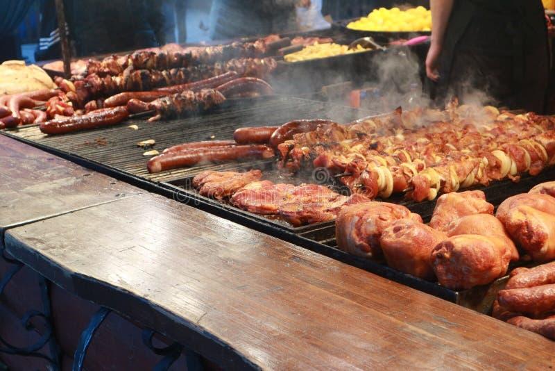 Street food: grilled sausages, shish kebab and pork knuckle stock images