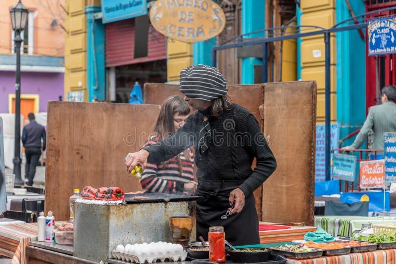 Street food in La Boca disctrict of Buenos Aires in Argentina. Street food being prepared in La Boca disctrict of Buenos Aires in Argentina stock image