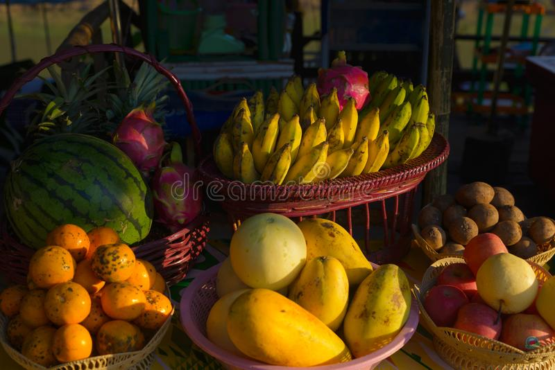 Street food in Luang Prabang, Laos. Delicious tropical fruit stall by sunset light. Asian cuisine, tasty food, healthy lifestyle stock image