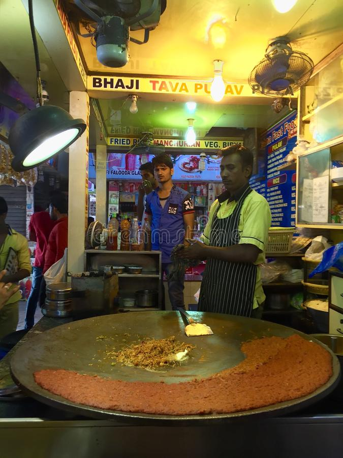 Street Food in Mumbai - Juhu beach, India. A street food stall at Juhu beach where Pav Bhajji (local fast food) is being prepared. The food court at its main royalty free stock photography