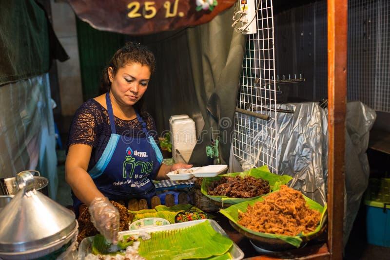 Street food at the Night Market in Hua Hin. Hua Hin, Thailand – January 16, 2013: Thai woman sells street food at the night market in Hua Hin. The famous royalty free stock photography