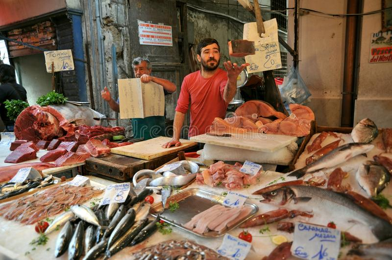 Street food in Palermo, Italy with tuna fish seller in a market. Street food in Palermo, Sicily, Italy with tuna fish seller . Outdoor fish market in Palermo stock photography
