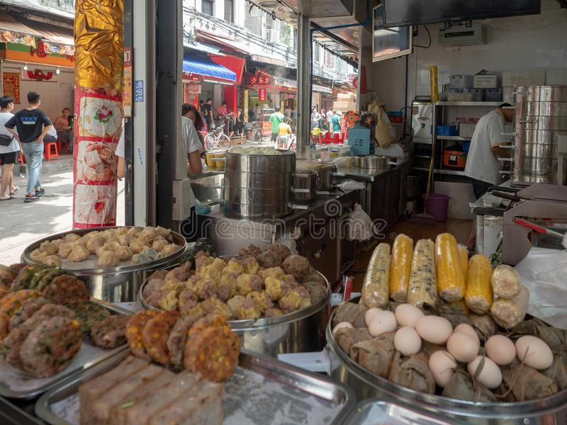 Street food restaurant in Guangzhou, China. Guangzhou/China - August 18 2018: Street food restaurant at Hai zhu nan lu street in the Old Town of Guangzhou stock photos