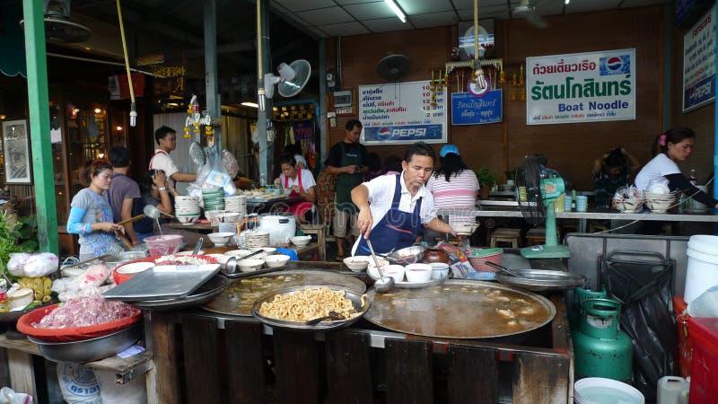 Street Food stall in Bangkok. Bangkok, Thailand- June 10, 2015: Food stall in Chatuchak weekend market, Bangkok. A men busy preparing the food for customers stock image