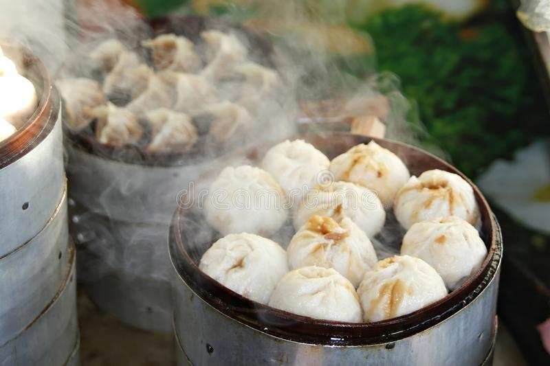 Street food -Steamed Dumplings in Beijing, China. Street food booth selling Chinese specialty Steamed Dumplings in Beijing, China royalty free stock images