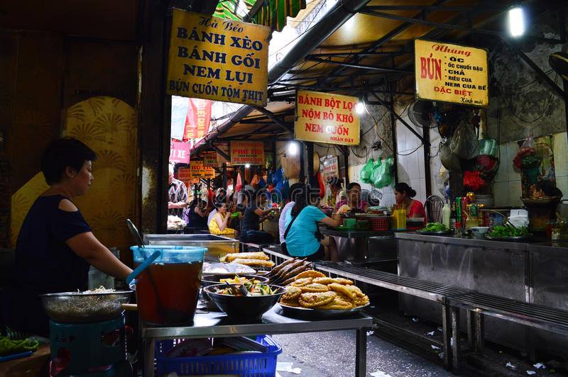 Street Food Street Hanoi. In the Old Quarter you`ll street food heaven, everything from Bun Cha to spring rolls, pho cuan and my favorite banh xeo stock images