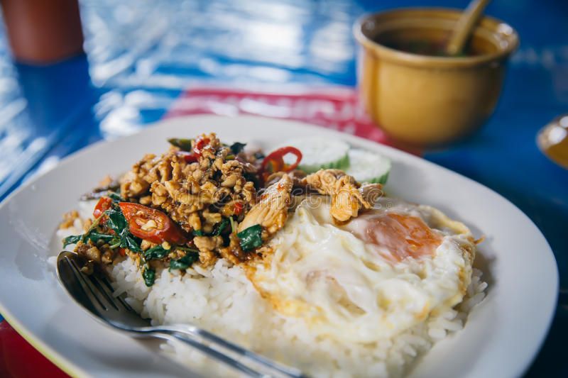 Street food in Thailand jasmine rice with stir-fried of chicken and basil leaf stock image