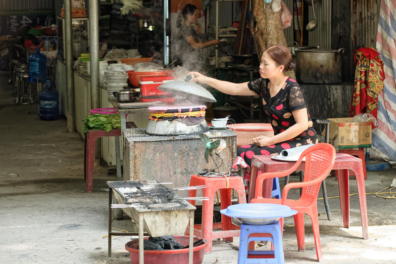 Street Food Vendor. A street food vendor in Hanoi, Vietnam stock photography