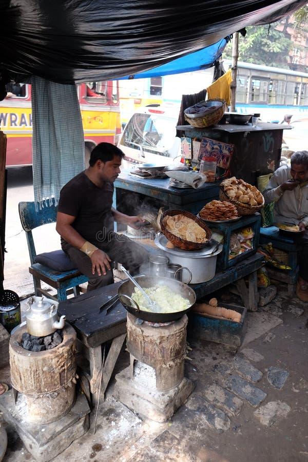 Street food vendor makes fried snacks in Kolkata stock image