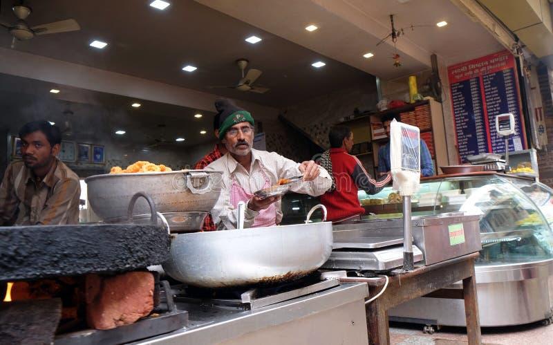 Street food vendor makes fried snacks in Pushkar, India royalty free stock photography